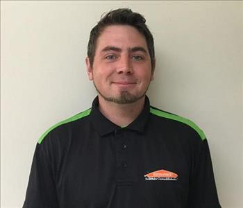 headshot of male technician short dark brown hair with a black SERVPRO shirt on.