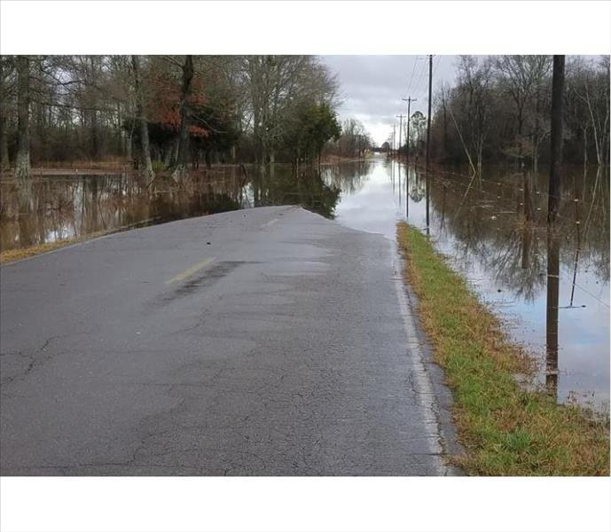 street in alabama flooded on both sides